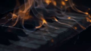 The fire is burning keys of a piano