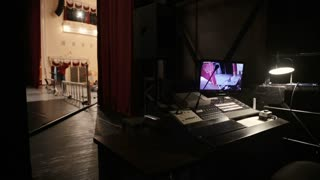 The place of a sound engineer behind the scenes in the theater.