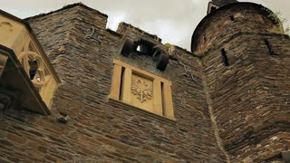 The walls of the castle are decorated with ironwork and moldings