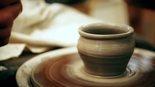 A potter is making pots
