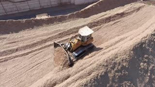 A tractor is collecting sawdust