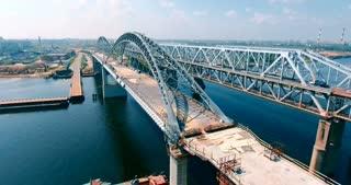 Aerial. A closed bridge over the river.