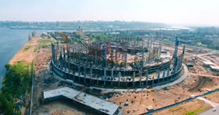 Aerial. Building of a stadium near a river.