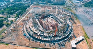 Aerial. Construction of a stadium near a city.