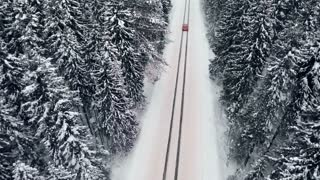 Aerial of a sports car on a winter road