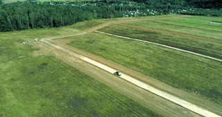 Construction of a new road in the middle of a field