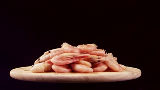 rotating Shrimps on a wooden stand