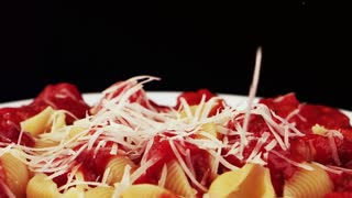 Sprinkle pasta with grated cheese