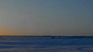 The sun is shining above the horizon in the Arctic