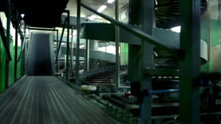 Tyres are falling to the conveyor