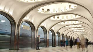 4K footage of People walking at the metro station. Mayakovskaya considered to be one of the most beautiful and famous metro stations in the world. Shot on On April 17, 2013 in Moscow, Russia.