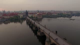 Aerial Prague panorama with Charles Bridges over Vltava river and Old Town architecture. View at sunset. Czech Republic, Europe