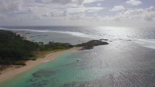 Aerial scenic shot of Mauritius Island coastal line and Indian Ocean in sunlight