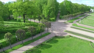 Aerial shot of beautiful green alleys and decorative lawns in Tsaritsyno museum and reserve, Moscow