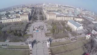 Aerial shot of cityscape with following view to the waterfront. Volgograd - city on the Volga river, Russia
