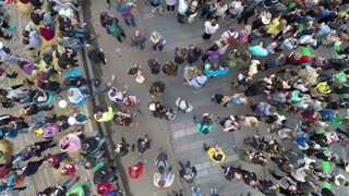 Aerial shot of crowd of people on city square. They coming to outdoor concert