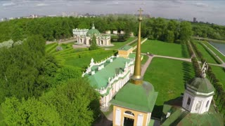Aerial shot of historic buildings ensemble with scenic green landscapes and big pond. Architecture museum Tsaritsyno, Moscow