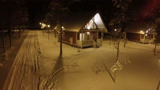 Aerial shot of the small village in the snowy winter night