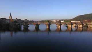Aerial view of famous historic Charles Bridge crossing the river Vltava in Prague, Czech Republic. Stone bridge was finished in 15th century