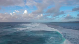 Aerial view of foamy waves of Indian Ocean rolling in lagoon on the coast of Mauritius Island