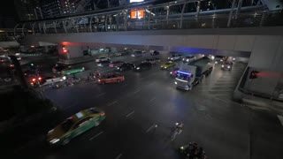 BANGKOK, THAILAND - NOVEMBER, 1, 2015: Overhead view of big road with a lot of cars, trucks, pedestrian crossing at night. Bangkok's multi-faceted sights, attractions and city life appeal to tourists
