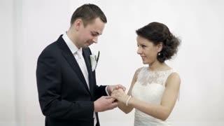 Bride and groom exchanging wedding rings. Wedding ceremony and rituals. Photoflashes blinking.