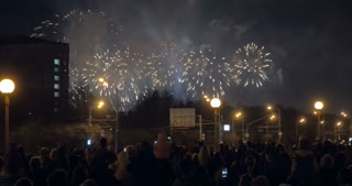 Celebration time in the city. People gathering in the street to watch night fireworks
