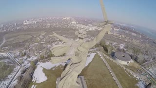 Flying over the giant statue of Motherland Calls on Mamaev Kurgan in Volgograd, Russia. Memorial complex devoted to the Great Patriotic War