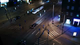 High angle shot of evening traffic in Tallin, Estonia. Crossroad with zebra and public transport stops