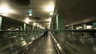 Hyperlapse shot of riding flat escalator and walking through the airport hall