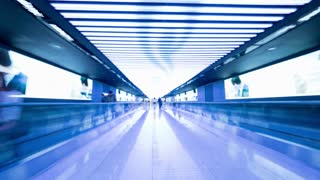 Hyperlapse shot of walking through the illuminated tunnel and light halls in the airport