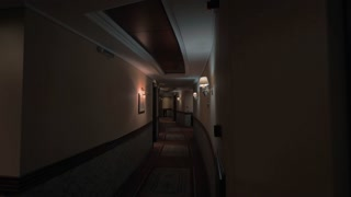 Interior of a hotel corridor. Design in warm tones with wall lamps giving dim light