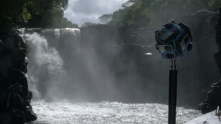 MAURITIUS - JUNE 17, 2016: Shooting 360 degrees video of nature with waterfall using six GoPro cameras fixed on tripod