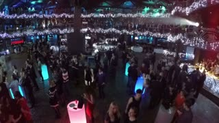 MOSCOW, RUSSIA - DECEMBER 27: Aerial shot of people relaxing on corporate party of Promsvyazbank. Dark club interior with garlands and colorful illuminated tables