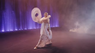 MOSCOW, RUSSIA - FEBRUARY 21, 2011: circus show, Circus performer juggling with three big white rings. Russia is visited by more than 20 million tourists annually