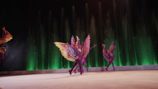 MOSCOW, RUSSIA - FEBRUARY 21, 2011: Slow motion shot of dancers on the ice performing fairy-tale personages and doing tricks. Show in Circus of Dancing Fountains Aquamarine
