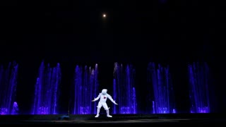 MOSCOW, RUSSIA - FEBRUARY 21, 2015: Dancing solo with acrobatic elements as part of theatrical performance in the Circus of Dancing Fountains Aquamarine