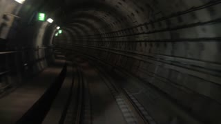 Motion along underground subway. Tunnel with lighting signs