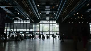 PARIS, FRANCE - SEPTEMBER 05, 2015: Timelapse shot of many people walking in and out Centre Georges Pompidou, famous museum of modern art