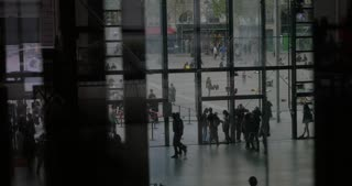 PARIS, FRANCE - SEPTEMBER 06, 2015: Pompidou Centre entrance lobby and view to the outdoor square with people sitting on the ground