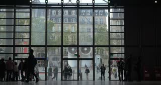 PARIS, FRANCE - SEPTEMBER 06, 2015: Timelapse of people walking in lobby of Centre Pompidou. Outdoor square can be seen through the windows. The third most visited landmark in Paris