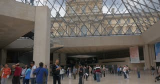 PARIS, FRANCE - SEPTEMBER 06, 2015: Visitors walking in the hall of Louvre Pyramid with following view of metal and glass ceiling