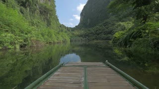 Scene with limestone karst mountain and quiet river in Trang An, Vietnam. View from sailing boat