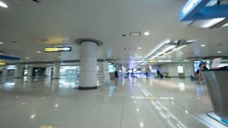 SEOUL, SOUTH KOREA - OCTOBER 22, 2015: Hyperlapse shot of walking through the halls and tunnels of Incheon International Airport, one of the largest and busiest airports in the world