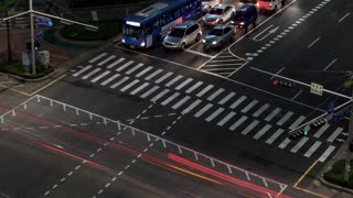 SEOUL, SOUTH KOREA - OCTOBER 22, 2015: Timelapse high angle shot of city transport traffic at night. Busy junction with traffic lights and zebra crossing