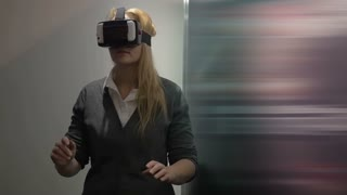 Slow motion of a woman having adventure in virtual world. She using augmented reality headset creating virtual space based on smartphone applications