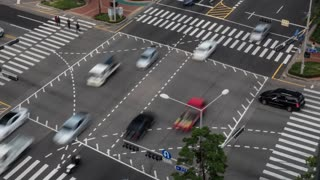 Timelapse high angle shot of car and motorbike traffic on busy crossroad in Seoul, South Korea