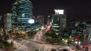 Timelapse high angle shot of night metropolis Seoul in South Korea. Illuminated buildings and busy city motorways