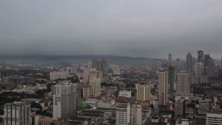 Timelapse panning shot of Kuala Lumpur in the evening and at night. Panorama with city architecture and transport. Capital of Malaysia
