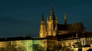 Timelapse shot of illuminated Prague Castle in late evening and night. Castle dated from 9th century is the official residence of the President of the Czech Republic